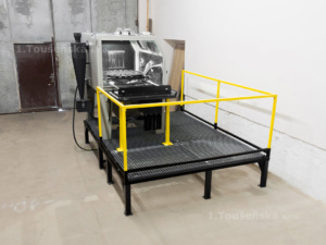 blasting machine with a rolling out turntable and a platform