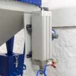 micro-blaster installed on a sandblasting machine