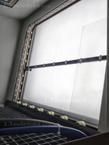 glass dulling inside a cabinet with roller tracks